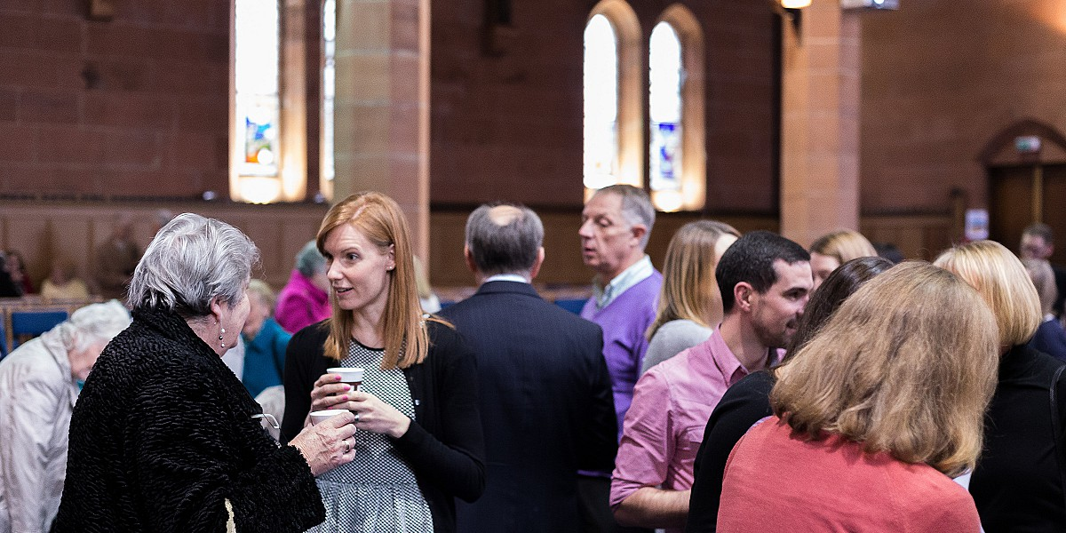 Members of the congregation chatting to eachother